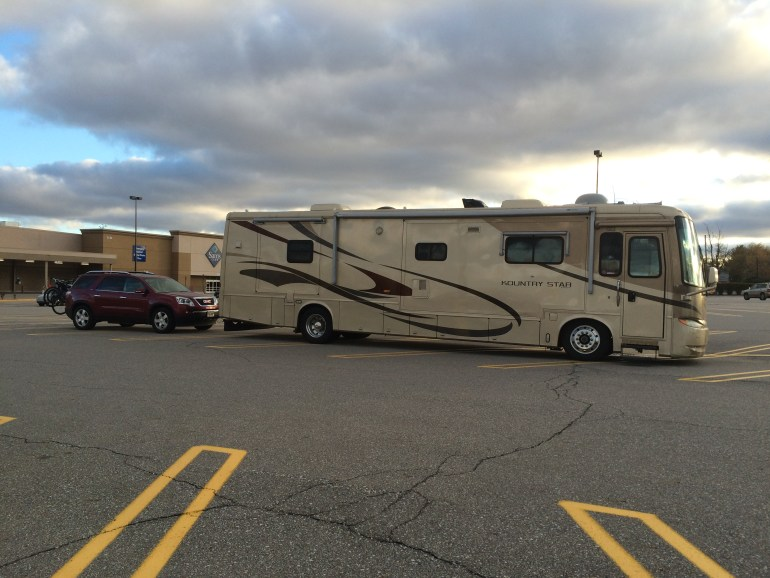 Parking lots offer a great way to camp for free in the USA. Missing something? Run into the store to pick it up!