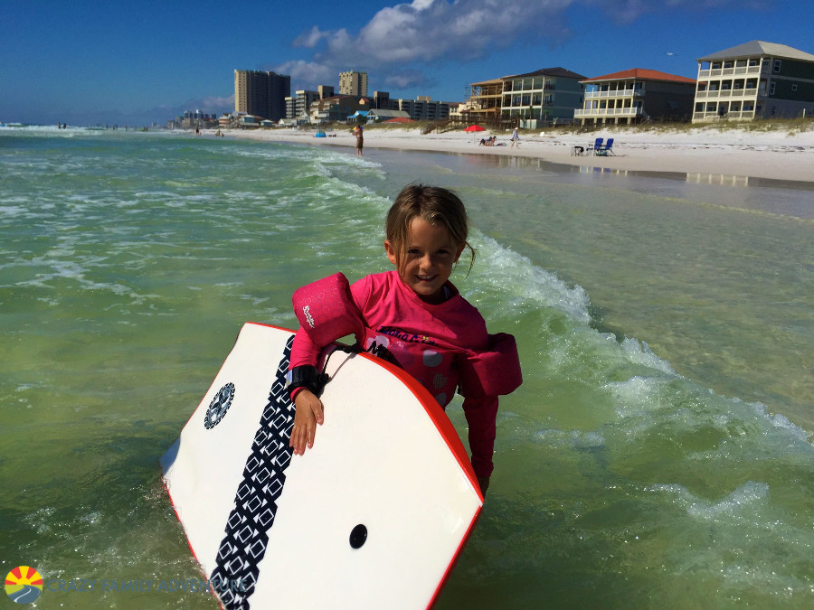 Melia hitting the waves was one of her favorite things to do in Destin Florida with kids