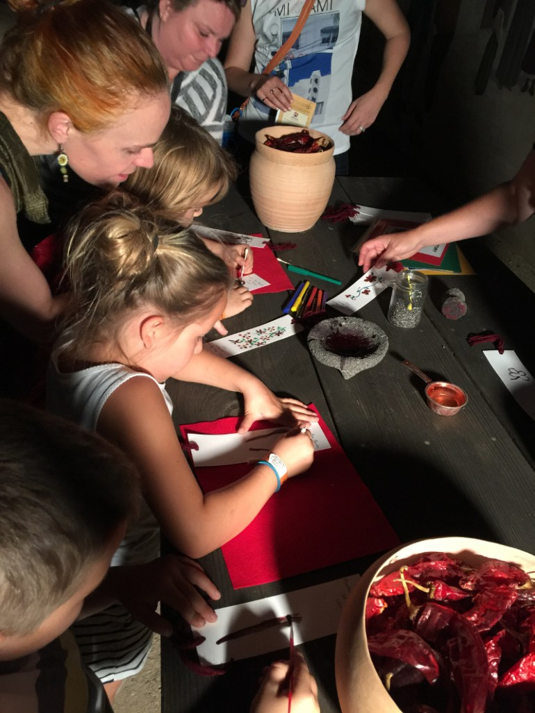 Making paint at Presidio San Augustin Museum is a great thing to do in Tucson with kids
