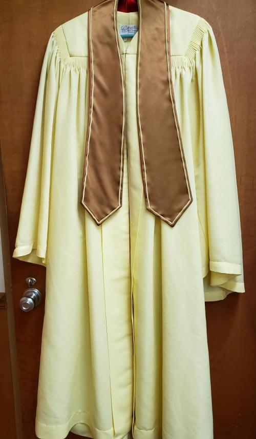 This image has an empty alt attribute; its file name is Choir-robe.jpg