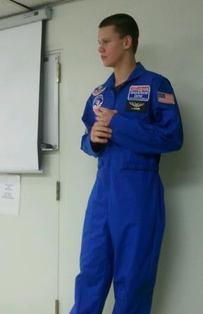 """Alex Beckerink, a recipient of the Lucile M. Wright Air Museum """"Space Camp"""" Scholarship, makes a presentation at the Air Museum in 2012 regarding his trip to Space Camp."""