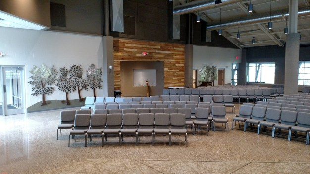 view from stage, legacy tree walls, exit to west side of building