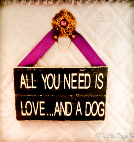 All you need is love..and a dog hung with a vintage brooch