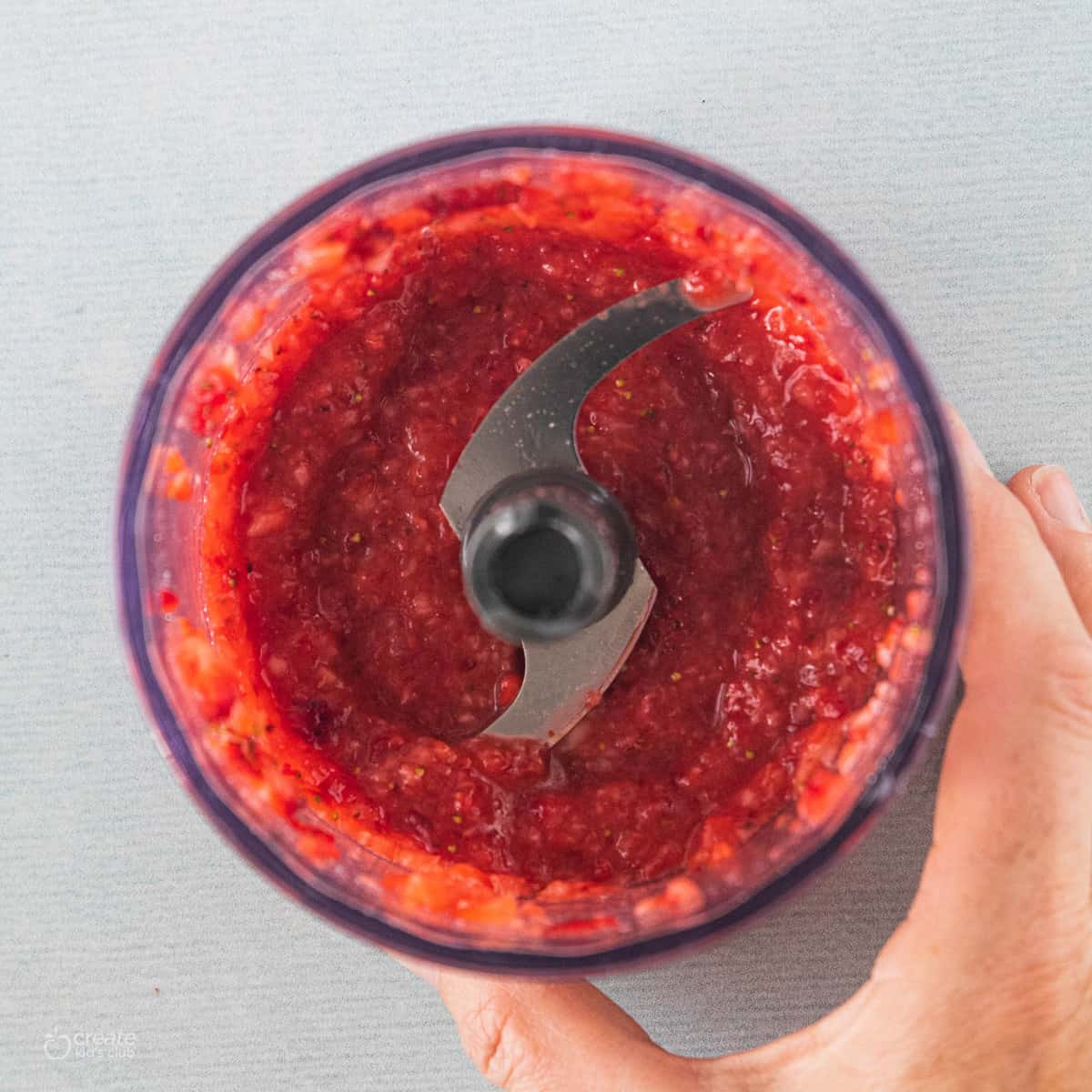 Strawberry puree in a blender.