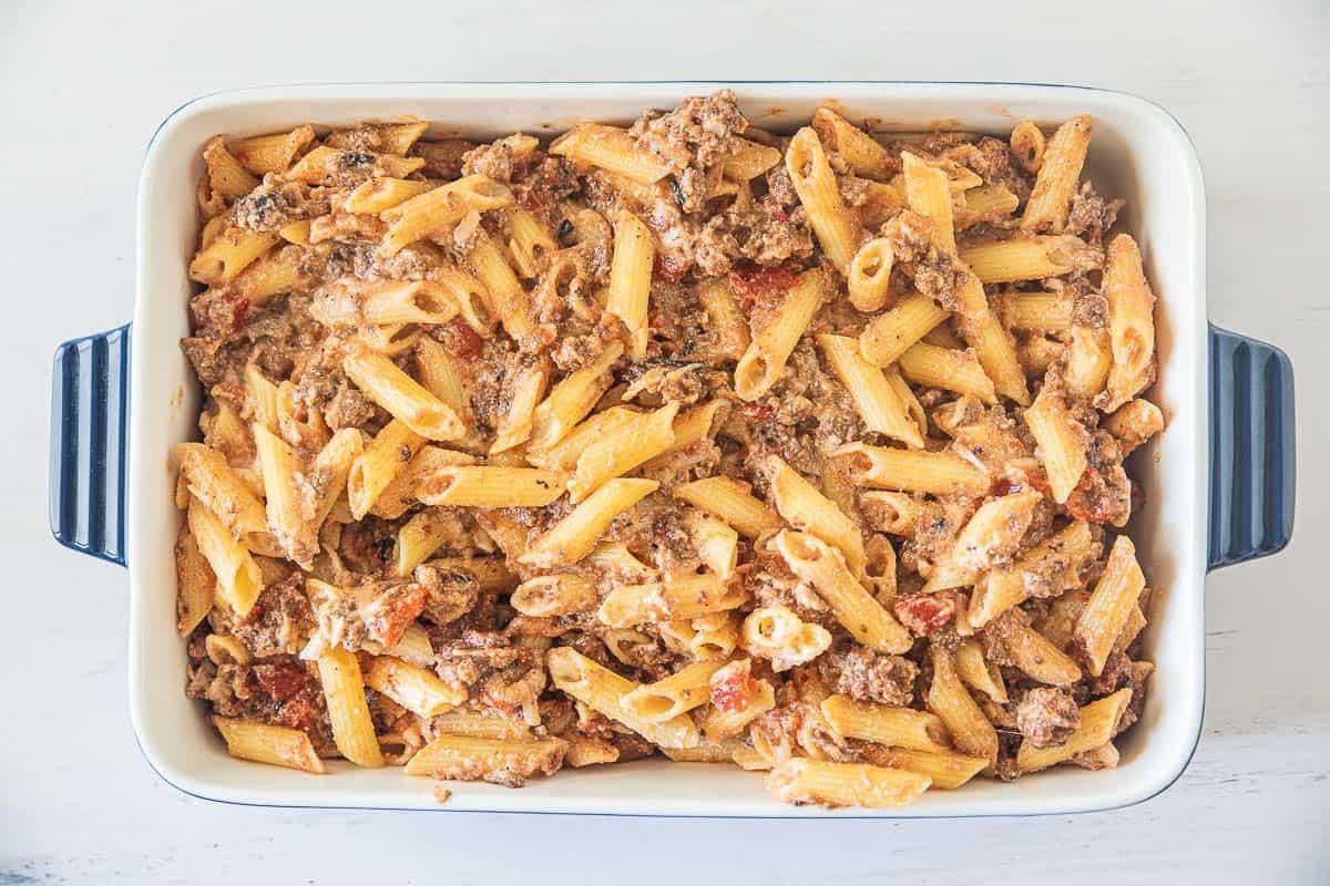 cheesy gluten free ziti with sausage in baking dish
