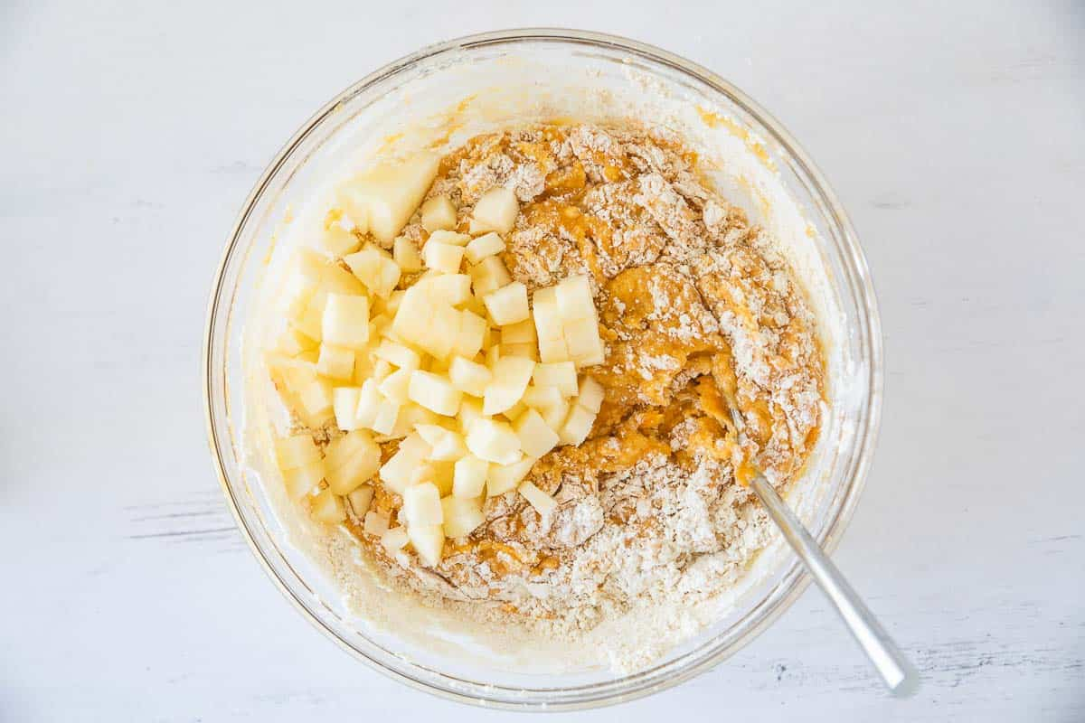 pumpkin muffin batter with apple chunks added