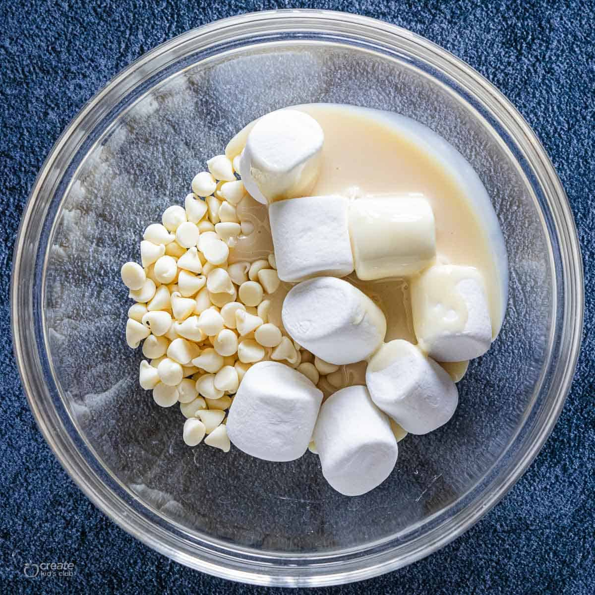marshmallows, evaporated milk and white chocolate chips in mixing bowl