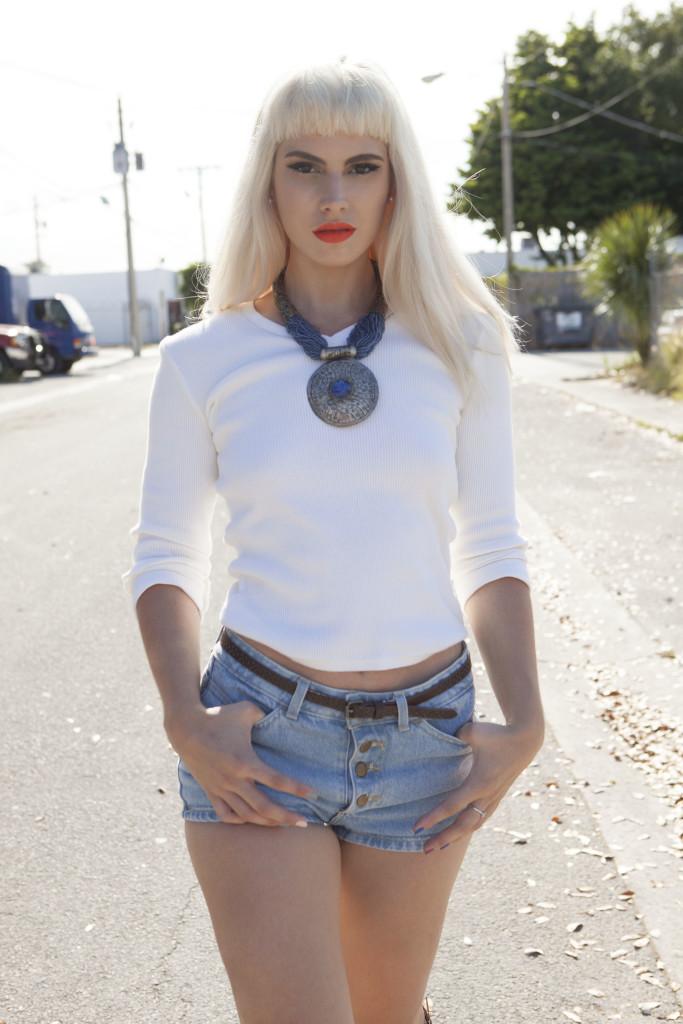 Blonde model orange lipstick daisy dukes.