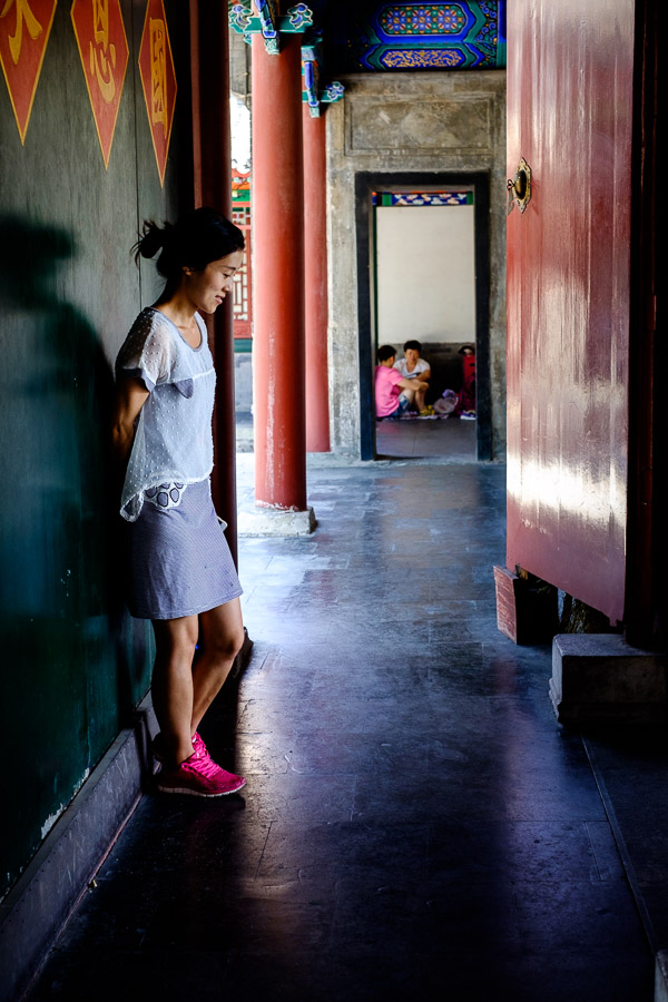 Street photo of a woman inside Prince Gong's mansion in Beijing, China