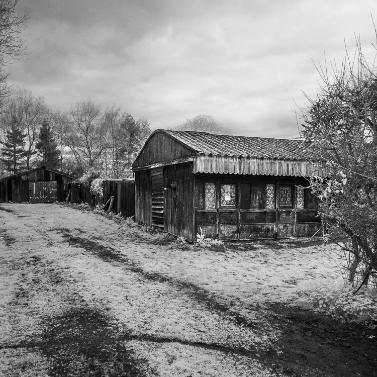 Black and white photo of an old barn in Norfolk taken with a Fujifilm X-Pro 1 camera converted to infrared