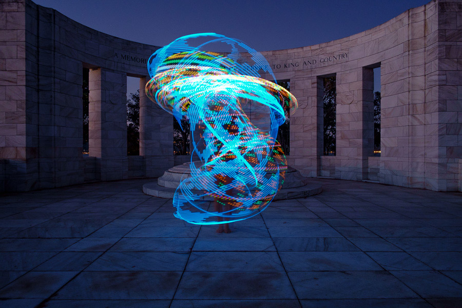 Photo of a dancer using a futurehoop to paint with light taken with Fujinon 18mm f2 lens