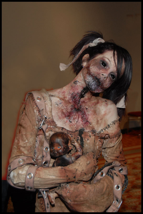 Creepy Girl Cradling Burnt Baby Doll