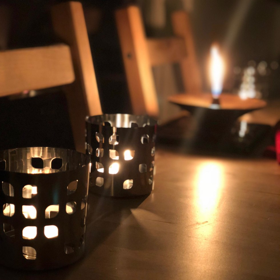 Prayer by candle and lamplight