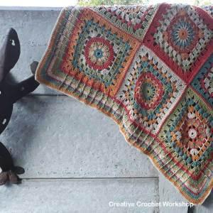 Cosmic Constellation Throw | Creative Crochet Workshop @creativecrochetworkshop #freecrochetpattern #grannysquare #afghansquare #crochetalong #ccwcrochetablock2018