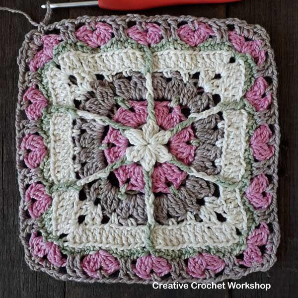 Snuggled Hearts Baby Blanket Tutorial | Creative Crochet Workshop @creativecrochetworkshop #crochetalong #grannysquare #afghansquare #crochetbabyblanket #ccwsnuggledheartsblanket #madewithheart