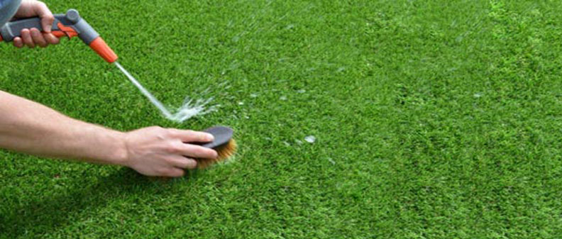 How to clean and care for synthetic turf. Water and traditional hand scrubbing is always the best bet!
