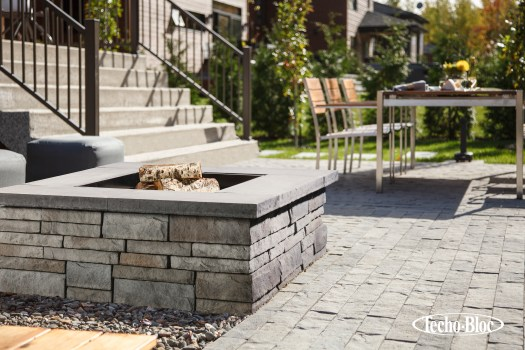Prescott fire feature is modern, with a touch of traditional wallstone texture.