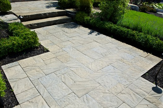 Wide front entrances or interlocking walkways, are inviting, comfortable, and practical.