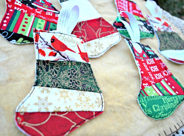 Scrap Fabric Stocking Ornaments: EASY way to use up that left over fabric!!!! Use to trim a gift, or throw a pocket on the back and place a gift card in it! #Christmas #ornament #giftideas #diychristmascraft