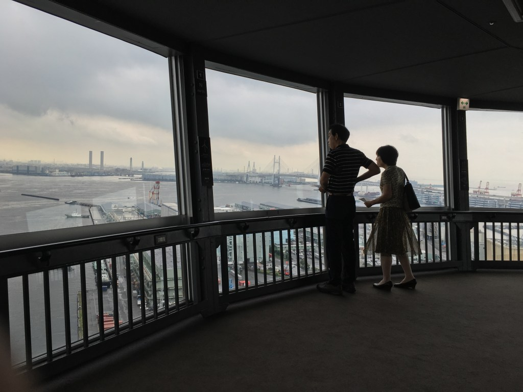 Couple enjoying a view from Marine Tower in Yokohama - iPhone 6S Plus Camera Review