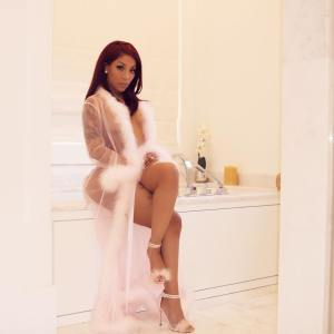 K Michelle Goes Nude again as she Strips down to Bikini Pants Only