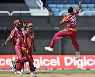 Jerome Taylor is airborne after getting rid of Dinesh Karthik, West Indies v India, 2nd ODI, Kingston, June 28, 2009