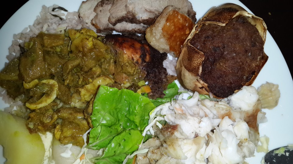Lobster, crispy pork, curry goat, chicken, salad, rice n peas and breadfruit adorned my plate