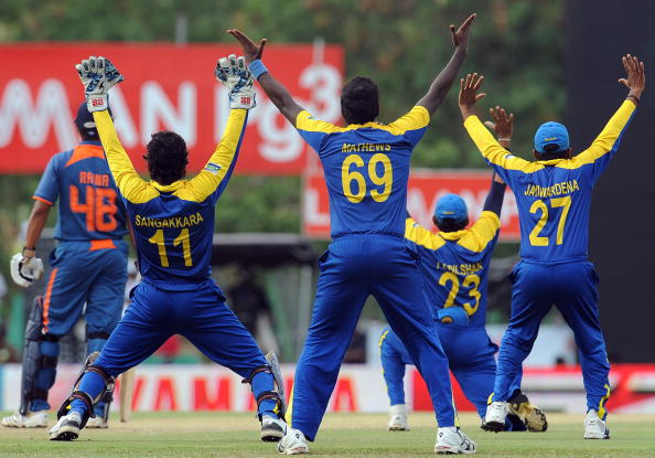 Sri Lankan captain and wicketkeeper Kumar Sangakkara (2L), Angelo Mathews (C), Mahela Jayawardene (R), Tillakaratne Dilshan (2 R) unsuccessfully appeals for a Leg Before Wicket (LBW) decision against Indian batsman Suresh Raina (L) during the fifth One Day International (ODI) cricket match of the Micromax tri-series between Sri Lanka and India at the Rangiri Dambulla International Cricket stadium in Dambulla, some 150 kms north of Colombo, on August 22, 2010. Thisara Perera grabbed a maiden five-wicket haul as Sri Lanka dismissed India for 103 in a triangular one-day series match on Sunday. AFP PHOTO/ Lakruwan WANNIARACHCHI. (Photo credit should read Lakruwan WANNIARACHCHI./AFP/Getty Images)