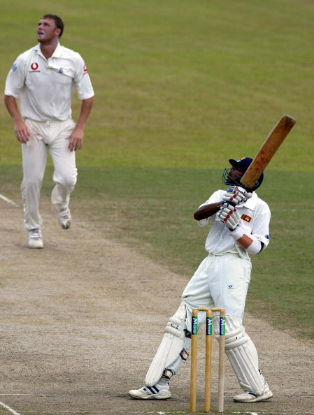 KANDY, SRI LANKA - DECEMBER 13: Tillakaratne Dilshan of Sri Lanka hits Andrew Flintoff of England for six during the fourth day of the Second Test between Sri Lanka and England at the Asgiriya Stadium December 13 2003 in Kandy, Sri Lanka. (Photo by Tom Shaw/Getty Images)