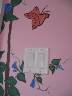 Buds and new blossoms trail off behind the light switch