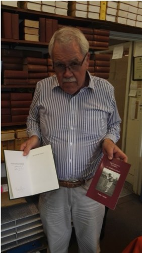 John McKenzie: Publisher of the volume, holding the limited edition signed by Everton Weekes and Tony Cozier and the regular edition with stiffened wrappers. Photo courtesy: Arunabha Sengupta