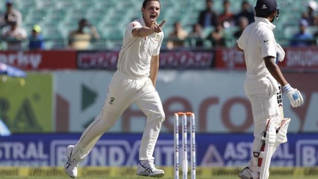 Australia's Josh Hazlewood celebrates the dismissal of India's Murali Vijay
