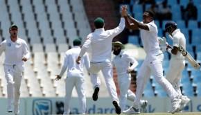 South Africa's bowler Lungi Ngidi, second right, celebrates with teammates after dismissing India's batsman Hardik Pandya