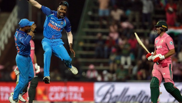 India's bowler Hardik Pandya, middle, celebrates with teammate Yuzvendra Chahal