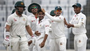Teammates congratulate Bangladesh's Mehedi Hasan Miraz