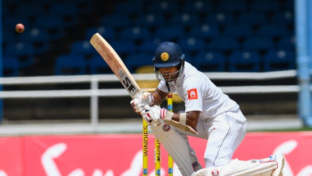 Dinesh Chandimal of Sri Lanka takes evasive action during