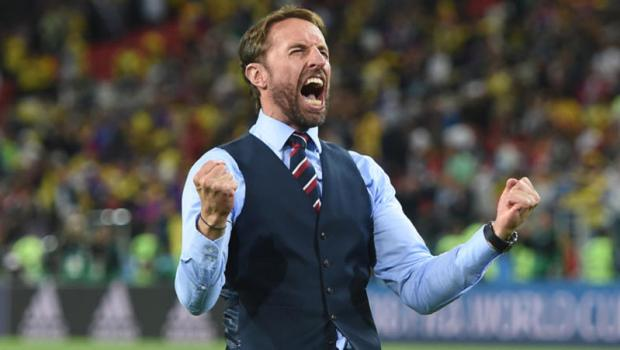 Head coach Gareth Southgate of England celebrates victory