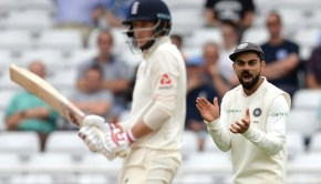 Virat Kohli of India claps his hands as Joe Root of England