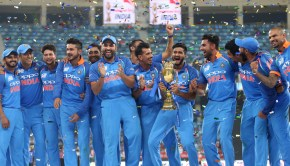 Indian players celebrate with the trophy after winning the Asia Cup final