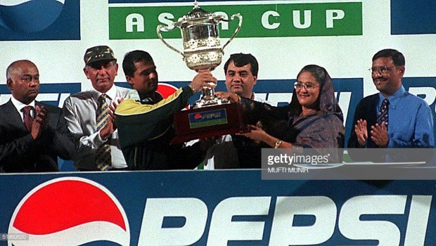 akistani captain Moin Khan receives the seventh Asia Cup trophy from Bangladeshi Prime Minister Sheikh Hasina