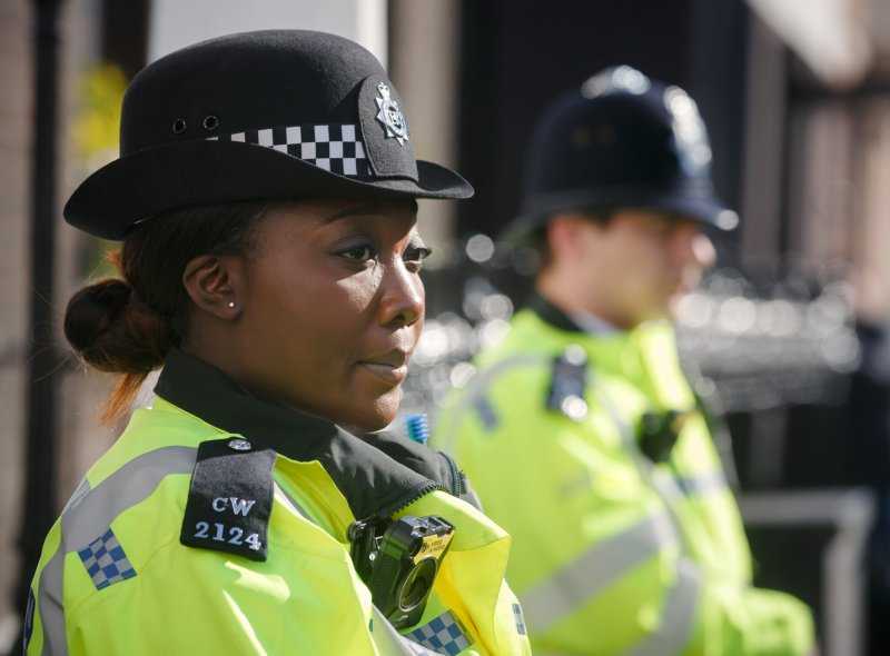 A female police officer stares into the distance