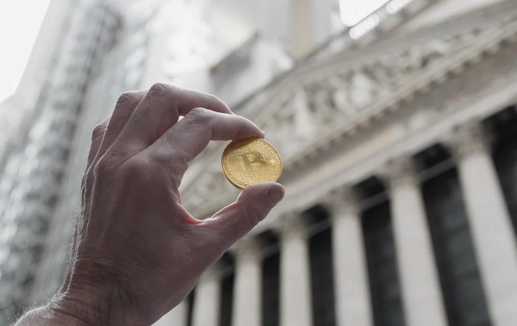 Aunque Wall Street se resista, Bitcoin nació para descentralizar