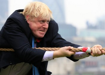 Mayor of London Boris Johnson takes part in a tug of war with personnel from the Royal Navy, the Army and the Royal Air Force at the launch of London Poppy Day, on Potters Field, next to City Hall in London.