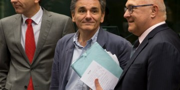 Newly appointed Greek Finance Minister Euclid Tsakalotos (C) is welcomed by Eurogroup President Jeroen Dijsselbloem (L) and French Finance Minister Michel Sapin at a euro zone finance ministers meeting on the situation in Greece in Brussels, Belgium, July 7, 2015. Greece faces a last chance to stay in the euro zone on Tuesday when Prime Minister Alexis Tsipras puts proposals to an emergency euro zone summit after Greek voters resoundingly rejected the austerity terms of a defunct bailout. REUTERS/Philippe Wojazer