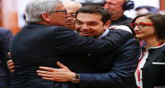 epa04717601 Greek Prime Minister Alexis Tsipras (R) is welcomed by European Commission president Jean-Claude Juncker (L) for the EU Summit in Brussels, Belgium, 23 April 2015. The leaders of the European Union meet in Brussels to tackle an escalating migration crisis and the daily arrival of hundreds of would-be asylum seekers and migrants crossing the Mediterranean.  EPA/OLIVIER HOSLET