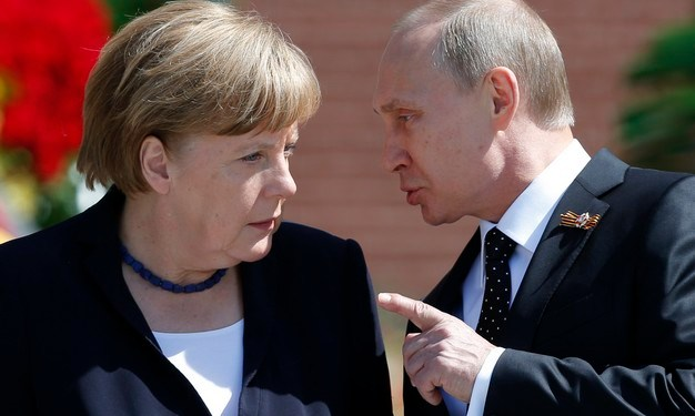 File photo of Russian President Vladimir Putin speaking with German Chancellor Angela Merkel