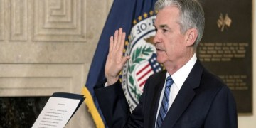 Jerome Powell takes the oath of office as Federal Reserve Board chairman at the Federal Reserve, Va., Monday, Feb. 5, 2018, in Washington. (AP Photo/Andrew Harnik)