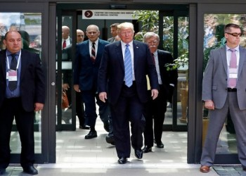 U.S. President Donald Trump is followed by National Security Advisor John Bolton (R) as he departs from the G7 summit in the Charlevoix city of La Malbaie, Quebec, Canada, June 9, 2018. REUTERS/Yves Herman