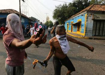 Opposition demonstrators clash with the Bolivarian National Guard in Urena, Venezuela, near the border with Colombia, Saturday, Feb. 23, 2019. Venezuela's National Guard fired tear gas on residents clearing a barricaded border bridge between Venezuela and Colombia on Saturday, heightening tensions over blocked humanitarian aid that opposition leader Juan Guaido has vowed to bring into the country over objections from President Nicolas Maduro(AP Photo/Fernando Llano)