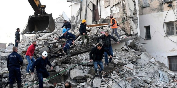 TOPSHOT - Emergency workers clear debris at a damaged building in Thumane, 34 kilometres (about 20 miles) northwest of capital Tirana, after an earthquake hit Albania, on November 26, 2019. - Four people died and some 150 were slightly injured in Albania after a 6.4 magnitude earthquake, the strongest in decades, rocked the Balkan country early Tuesday. The epicentre of the quake was about 34 kilometres (about 20 miles) northwest of Tirana, according to the European-Mediterranean Seismological Centre. (Photo by Gent SHKULLAKU / AFP) (Photo by GENT SHKULLAKU/AFP via Getty Images)